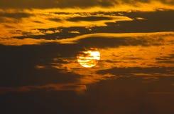 O sol de ajuste Imagem de Stock
