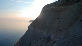 O sol do penhasco revela na baía ocidental Dorset filme