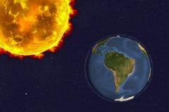 O sol e a terra Foto de Stock