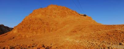 O sol está aumentando em Masada Fotografia de Stock Royalty Free