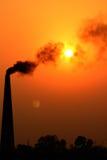 O sol, a lua e vertical da poluição Imagem de Stock Royalty Free