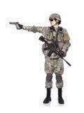 O soldado dispara em uma arma Fotos de Stock