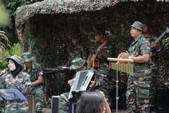 O soldado do malaio que canta no evento Imagem de Stock Royalty Free
