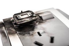 O soquete bonde para fora queimado colou com tomada quebrada Foto de Stock Royalty Free