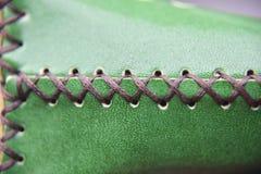 O stich no couro verde fotografia de stock royalty free