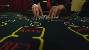 O stickman do casino toma os cart?es video estoque