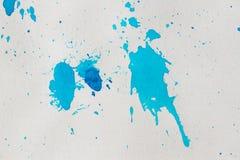 O sumário azul da aquarela espirra o fundo Foto de Stock