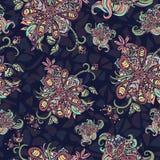 O sumário floresce o teste padrão sem emenda Garatuja colorido em um fundo azul Para o projeto da tela, matéria têxtil, papel de  Foto de Stock