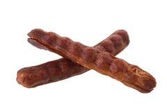 O tamarindo maduro doce remove as sementes e o shell isolados em um whi Imagem de Stock