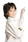 O tape-measure longo do desejo do rapaz pequeno imagem de stock royalty free