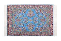 O tapete azul retangular encontra-se horizontalmente fotografia de stock royalty free