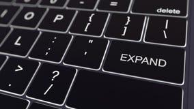 O teclado de computador preto e a incandescência expandem a chave Rendição 3d conceptual Imagens de Stock