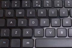 O teclado preto abotoa ascendente próximo do sumário Foto de Stock