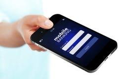O telefone celular com a página móvel do início de uma sessão da operação bancária holded à mão o isolador imagens de stock royalty free