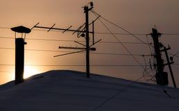 O telhado nos raios do nascer do sol Fotografia de Stock