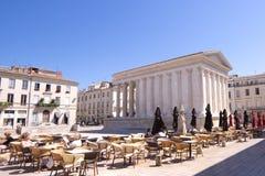 O templo romano Maison Carree em Nimes, França Imagens de Stock Royalty Free