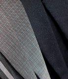 O terno veste a fotografia do fundo Fotos de Stock