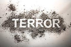 O terror da palavra escrito na cinza como o terrorismo, guerra, morte, assassinato, fotos de stock royalty free