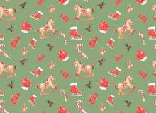 o teste padrão da aquarela com Natal brinca em um fundo colorido foto de stock
