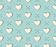 O teste padrão sem emenda com coração e as setas no vintage denominam a gravura em um fundo de turquesa para o dia de Valentim Mã Fotografia de Stock