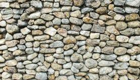 O teste padrão sem emenda da natureza do grupo rachou a pedra que conecta como parede ou que pavimenta o teste padrão no estilo r Imagem de Stock