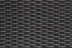 O teste padrão de madeira de superfície do close up no preto pintou o fundo de madeira da textura da cadeira do weave Foto de Stock