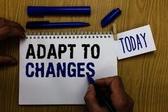O texto da escrita adapta-se às mudanças Homem novo do progresso da adaptação do crescimento das oportunidades do abraço do signi imagem de stock