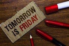 O texto da escrita da palavra é amanhã sexta-feira Conceito do negócio para o feriado feliz do fim de semana que toma o varrão no fotografia de stock royalty free