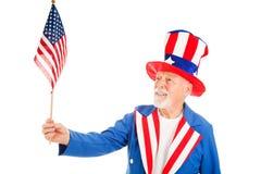 O tio Sam prende a bandeira dos E.U. imagem de stock