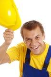 O trabalhador feliz descola seu chapéu duro Fotografia de Stock