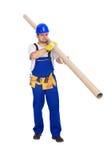 O trabalhador leva a tubulação longa Foto de Stock Royalty Free