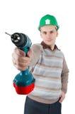O trabalhador prende uma broca em sua mão Imagem de Stock Royalty Free