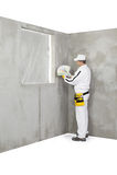 O trabalhador que guarda uma cor prova a paleta Fotografia de Stock