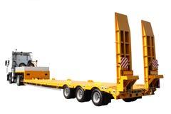 O trator com uma plataforma amarela Fotografia de Stock Royalty Free