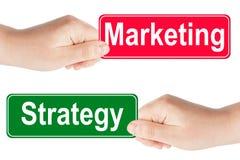 O tráfego da estratégia e do mercado assina dentro a mão Foto de Stock Royalty Free