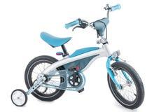 O triciclo de crianças azul em um fundo branco Fotografia de Stock Royalty Free