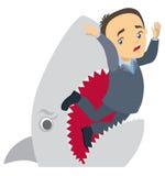 O tubarão devora o homem de negócios Imagens de Stock