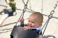 O um anos de idade bonitos no balanço Fotografia de Stock Royalty Free