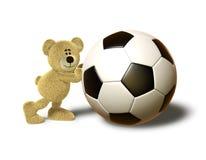 O urso de Nhi empurra uma esfera de futebol grande Imagem de Stock Royalty Free
