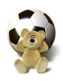 O urso de Nhi relaxa com esfera de futebol Fotografia de Stock
