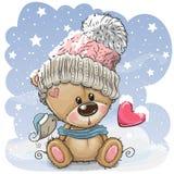 O urso de peluche dos desenhos animados em um tampão feito malha senta-se em uma neve ilustração royalty free