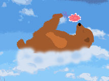 O urso feliz é uma nuvem com uma flor Fotos de Stock Royalty Free