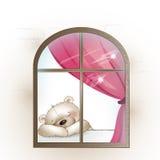 O urso senta-se pela janela e falta-se Foto de Stock