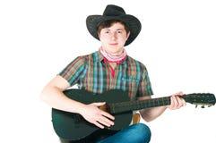 O vaqueiro com uma guitarra Imagens de Stock
