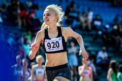 O velocista da menina corre sua raça Foto de Stock