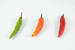 O vermelho alaranjado verde Chili Pepper Fotos de Stock Royalty Free