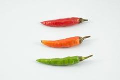 O vermelho alaranjado verde Chili Pepper Foto de Stock