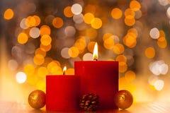 O vermelho Candles a flama do Xmas Luz do fundo de Bokeh Imagem de Stock Royalty Free