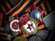 O ` vermelho da estrela do ` de Orden, sinal do ` guarda o ` e orden ` patriótico da guerra do ` o grande na fita do ` s de St Ge fotografia de stock royalty free