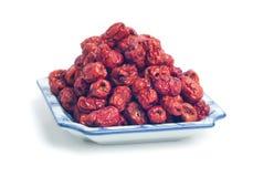 O vermelho data ingredientes chineses das ervas na placa Imagens de Stock